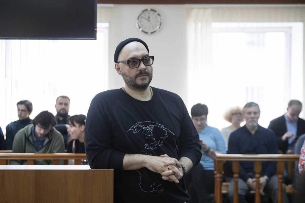 Russian theatre and film director Kirill Serebrennikov, center, waits a court hearing in Moscow, Russia, Monday, April 8, 2019. The Moscow City Court