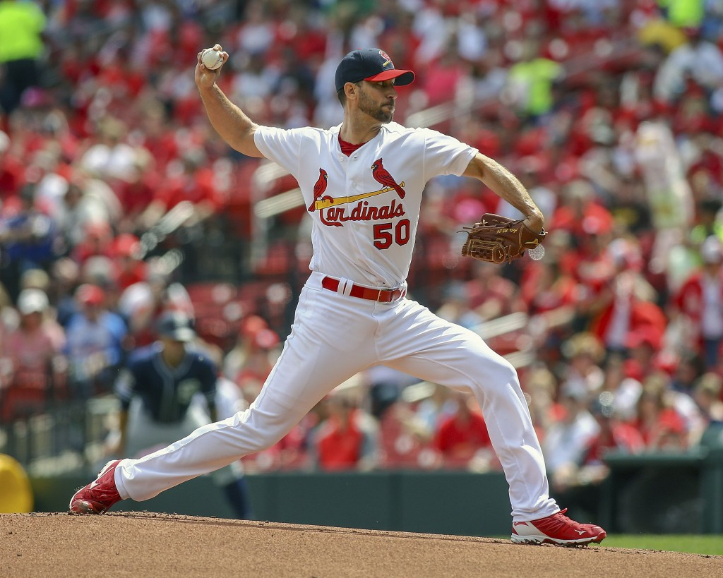 St. Louis Cardinals starting pitcher Adam Wainwright (50) pitches during the first inning of a baseball game against the San Diego Padres Sunday, Apri
