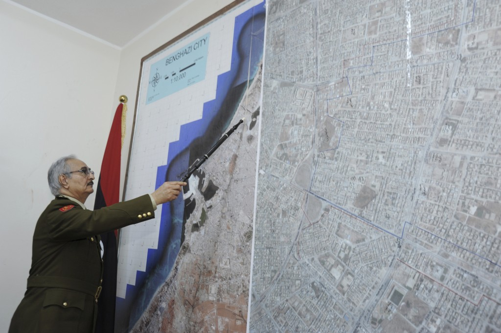 FILE - In this  In this Wednesday, March 18, 2015 photo, Gen. Khalifa Hifter, Libya's top army chief, points at a map in his office during an intervie