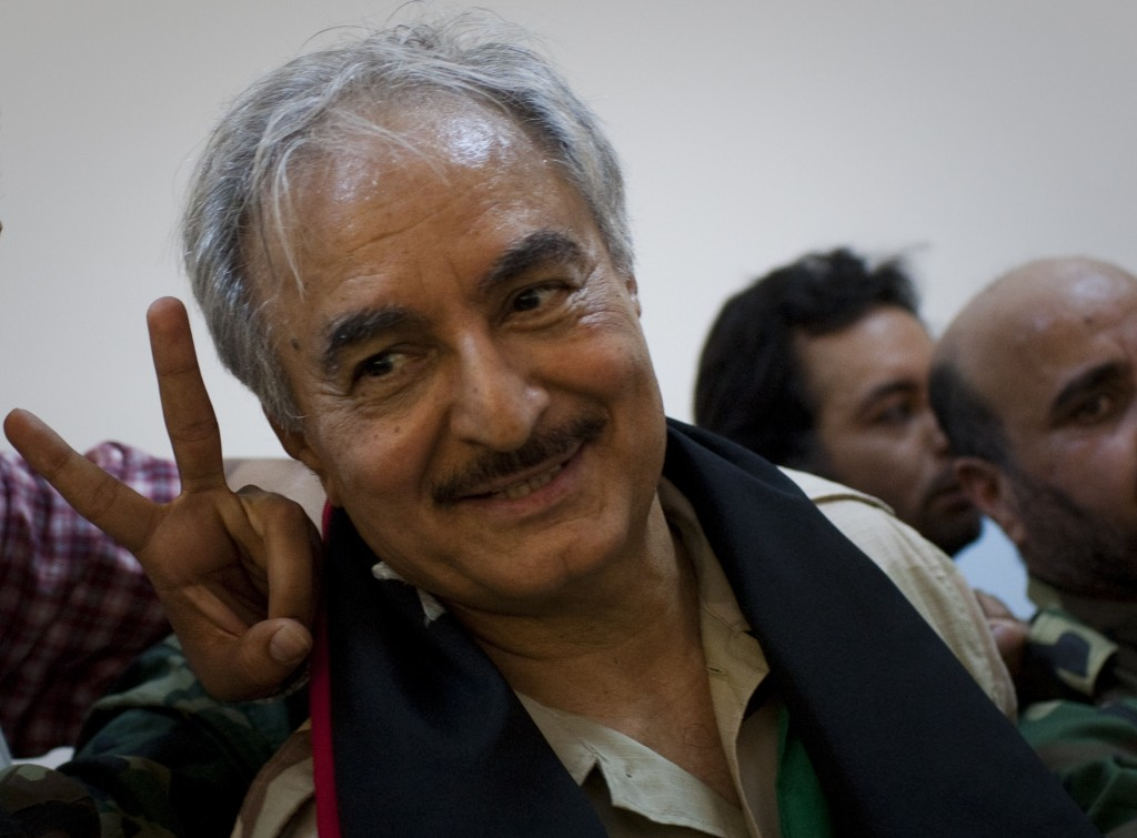 FILE - In this Friday, March 18, 2011 file photo, then Libyan senior Rebel commander Khalifa Hafter leaves a press conference in the court house in th