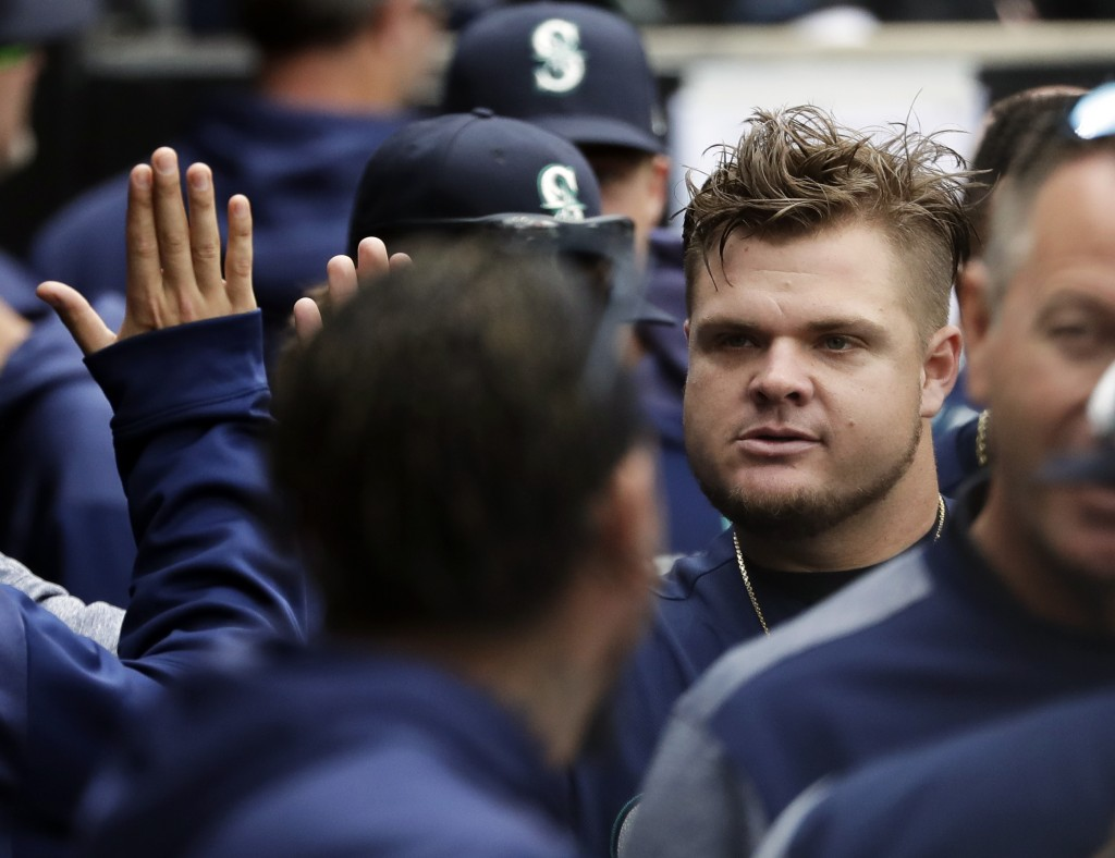 Seattle Mariners' Daniel Vogelbach, right, celebrates with teammates in the dugout during the third inning of a baseball game against the Chicago Whit...