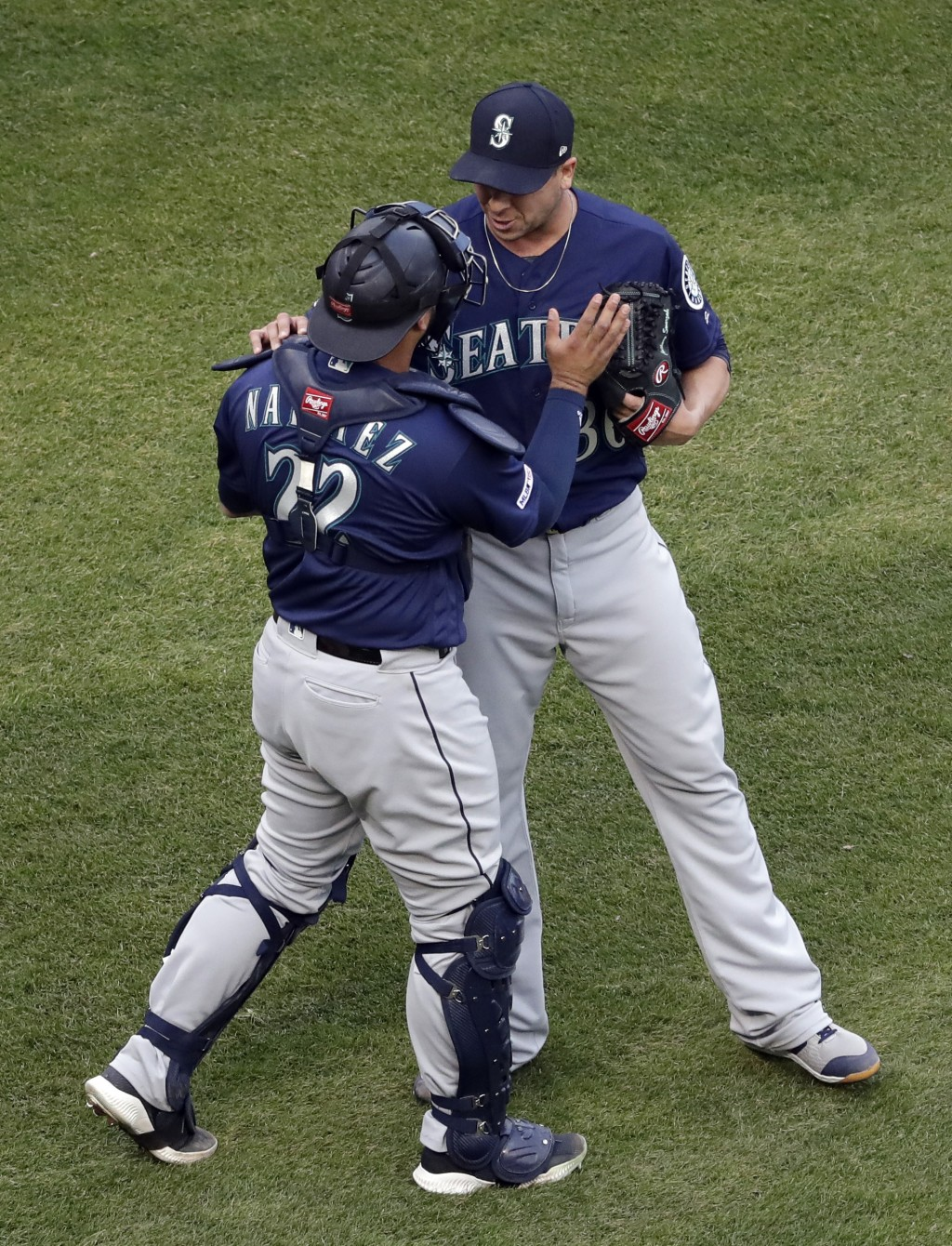 Seattle Mariners relief pitcher Anthony Swarzak, right, celebrates with catcher Omar Narvaez after they defeated the Chicago White Sox in Chicago, Sun...