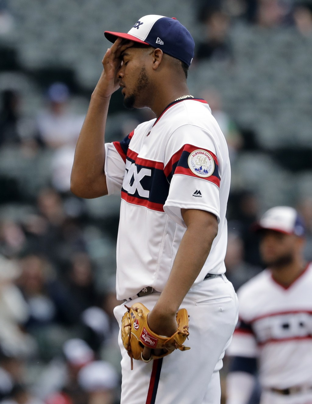 Chicago White Sox starting pitcher Ivan Nova reacts after Seattle Mariners' Tim Beckham walked to first during the third inning of a baseball game in ...