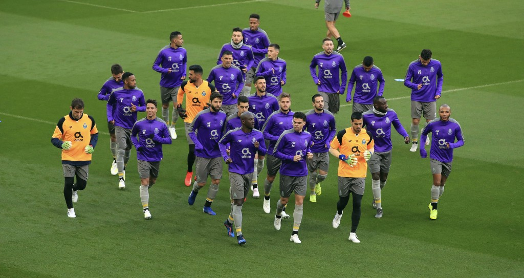Porto's Danilo Pereira, front left, Pepe, front right, and Iker Casillas, far left, attend a training session at Anfield, Liverpool, England, Monday,