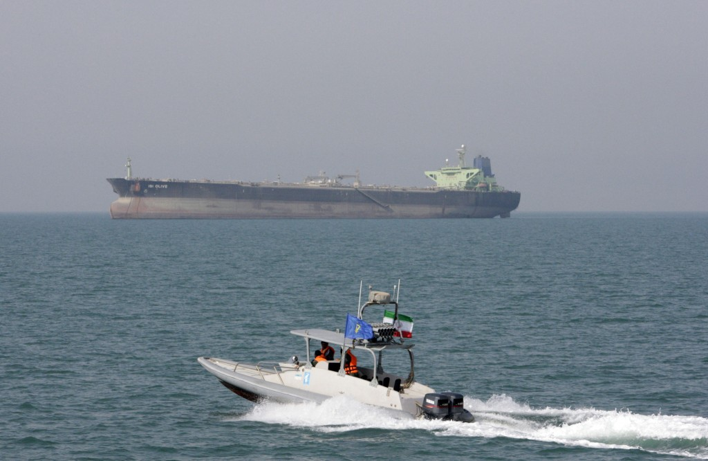 FILE - In this July 2, 2012 file photo, an Iranian Revolutionary Guard speedboat moves in the Persian Gulf near an oil tanker. On Monday, April 8, 201...