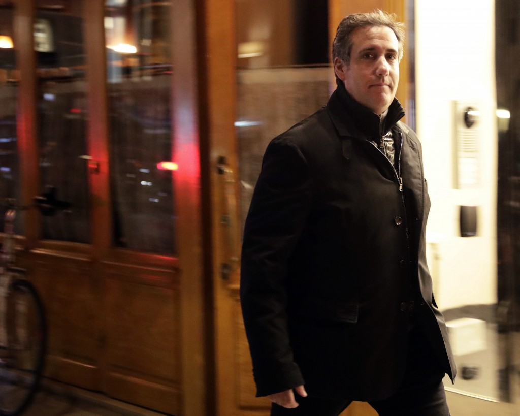 FILE - In this April 10, 2018, file photo, Michael Cohen, President Donald Trump's personal attorney, walks to his hotel in New York. A year ago Tuesd...