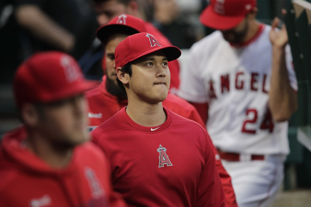 Los Angeles Angels' Shohei Ohtani, of Japan, walks through the dugout before a baseball game against the Milwaukee Brewers, Monday, April 8, 2019, in