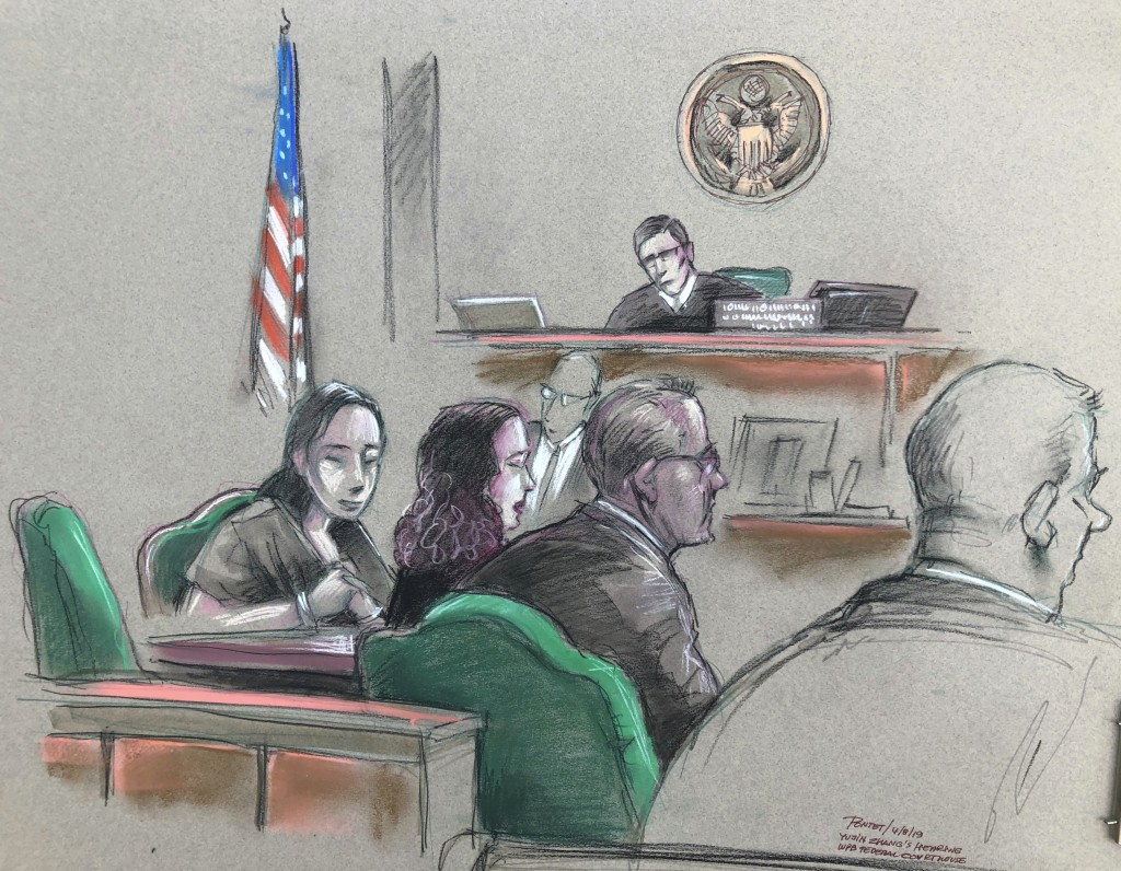 In this artist sketch, a Chinese woman, Yujing Zhang, left, listens to a hearing Monday, April 8, 2019, before federal Magistrate Judge William Matthe