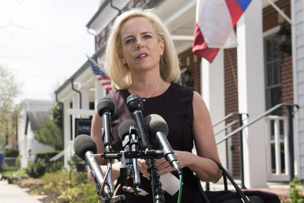 Homeland Security Secretary Kirstjen Nielsen talks outside her home in Alexandria, Va., on Monday, April 8, 2019. Nielsen says she continues to suppor...