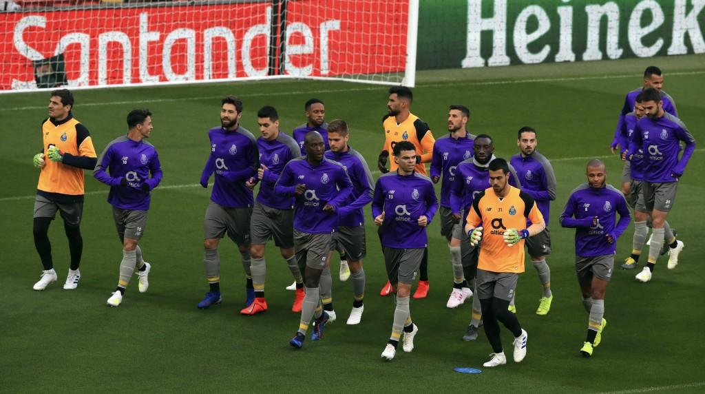 Porto's Danilo Pereira, center, Pepe, center right, and Iker Casillas, far left, attend a training session at Anfield, Liverpool, England, Monday, Apr