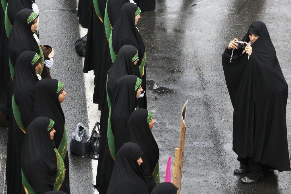 FILE - In this Nov. 25, 2011 file photo, female members of the Iranian paramilitary Basij force, affiliated with the Revolutionary Guard stand in form...
