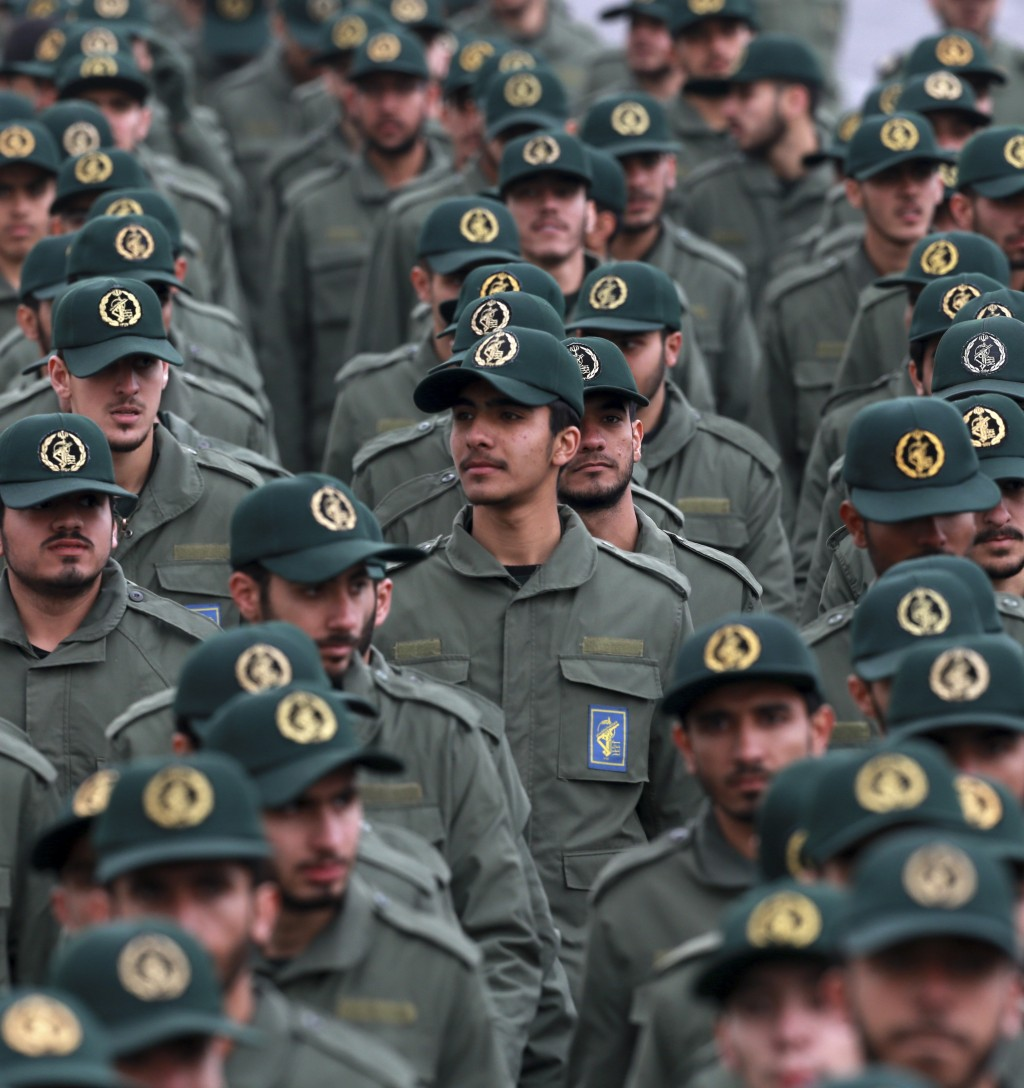 In this Feb. 11, 2019 file photo, Iranian Revolutionary Guard members attend a ceremony celebrating the 40th anniversary of the Islamic Revolution, at