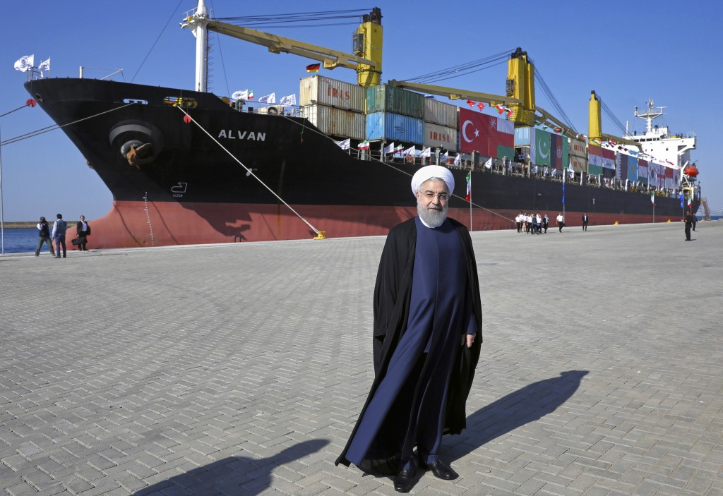 FILE - In this Dec. 3, 2017 file photo, Iranian President Hassan Rouhani poses during the inauguration a newly built extension of the port of Chabahar...