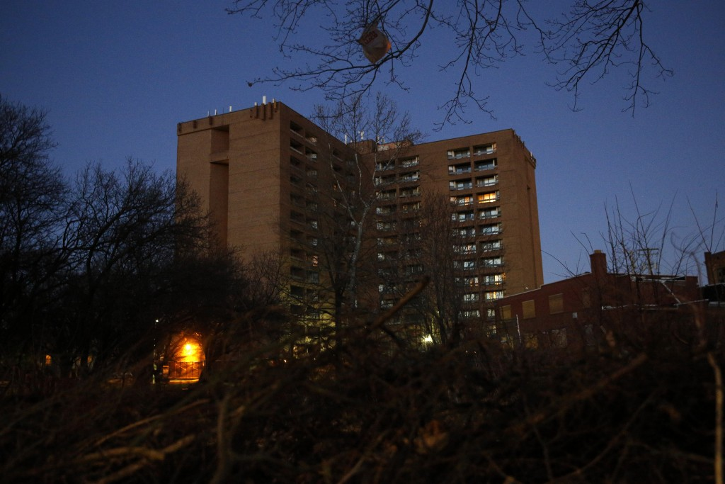 In this Feb. 25, 2019 photo, dusk settles over Rosemont Tower in Baltimore. Health and safety inspectors gave the 200-unit public housing high-rise a ...