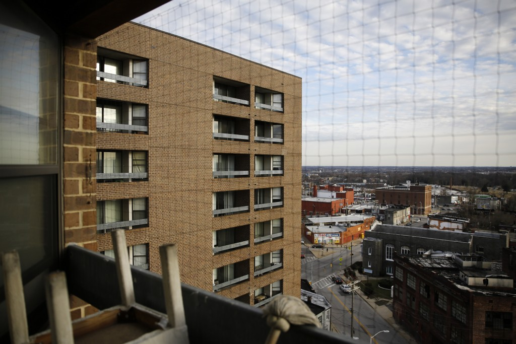 This Feb. 26, 2019, photo shows Rosemont Tower in Baltimore from a resident's balcony. Health and safety inspectors gave the 200-unit public housing h...