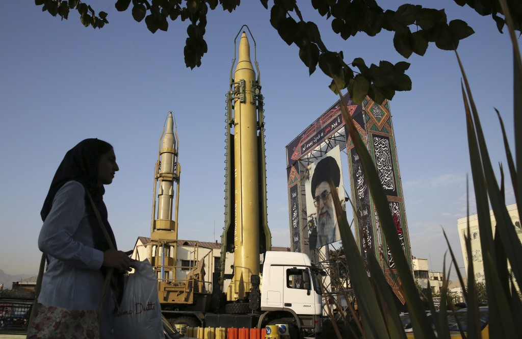 FILE-- In this Sept. 24, 2017 file photo, surface-to-surface missiles and a portrait of the Iranian Supreme Leader Ayatollah Ali Khamenei are displaye