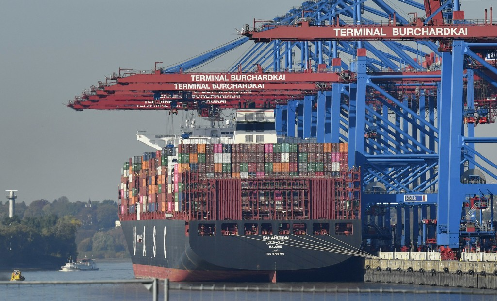 FILE - In this Monday, Oct. 15, 2018 file photo, a container ship is loaded at the harbor in Hamburg, Germany. The United States is considering puttin