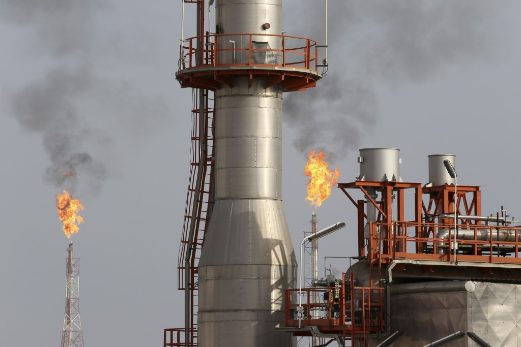 FILE - This March 16, 2019 file photo, shows a natural gas refinery at the South Pars gas field constructed by Revolutionary Guard-affiliated company,...