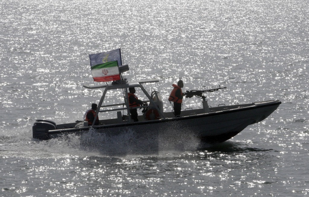 FILE - In this July 2, 2012 file photo, an Iranian Revolutionary Guard speedboat participates in a ceremony remembering the 290 passengers of an Irani