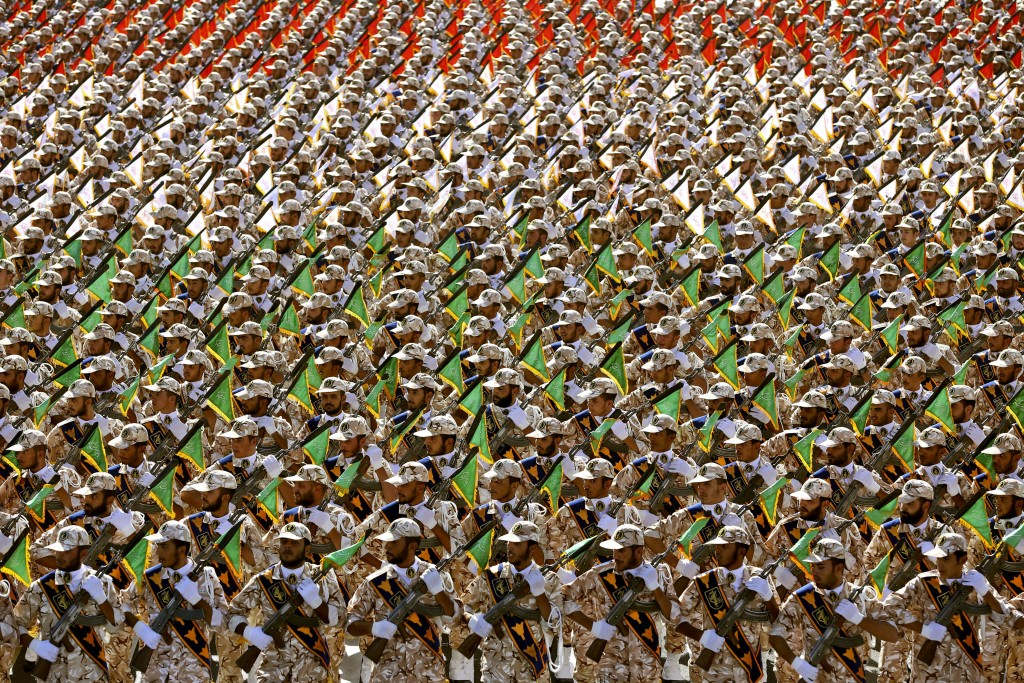 FILE - In this Sept. 22, 2014 file photo, members of the Iran's Revolutionary Guard march during an annual military parade at the mausoleum of Ayatoll...