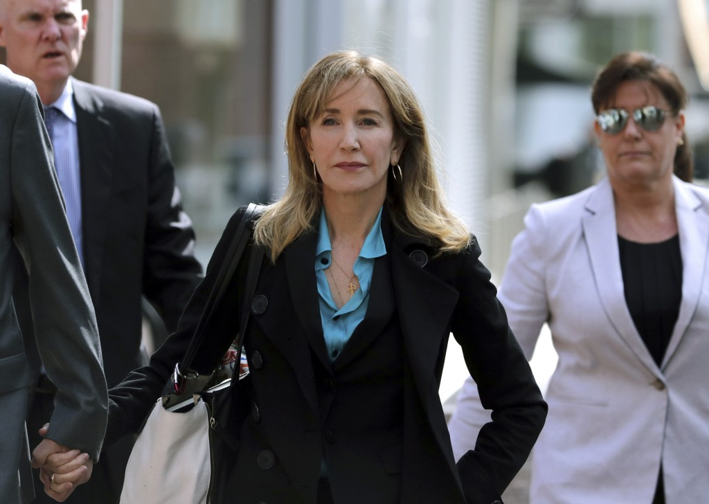 FILE - This April 3, 2019 file photo shows actress Felicity Huffman arriving at federal court in Boston to face charges in a nationwide college admiss