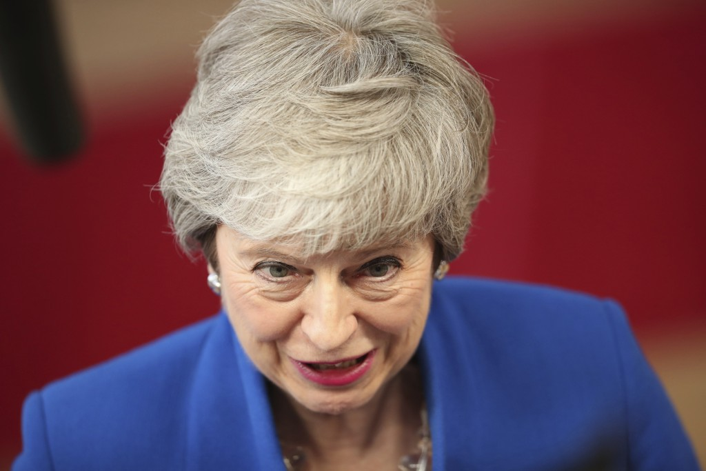 British Prime Minister Theresa May speaks as she arrives for an EU summit at the Europa building in Brussels, Wednesday, April 10, 2019. European Unio...