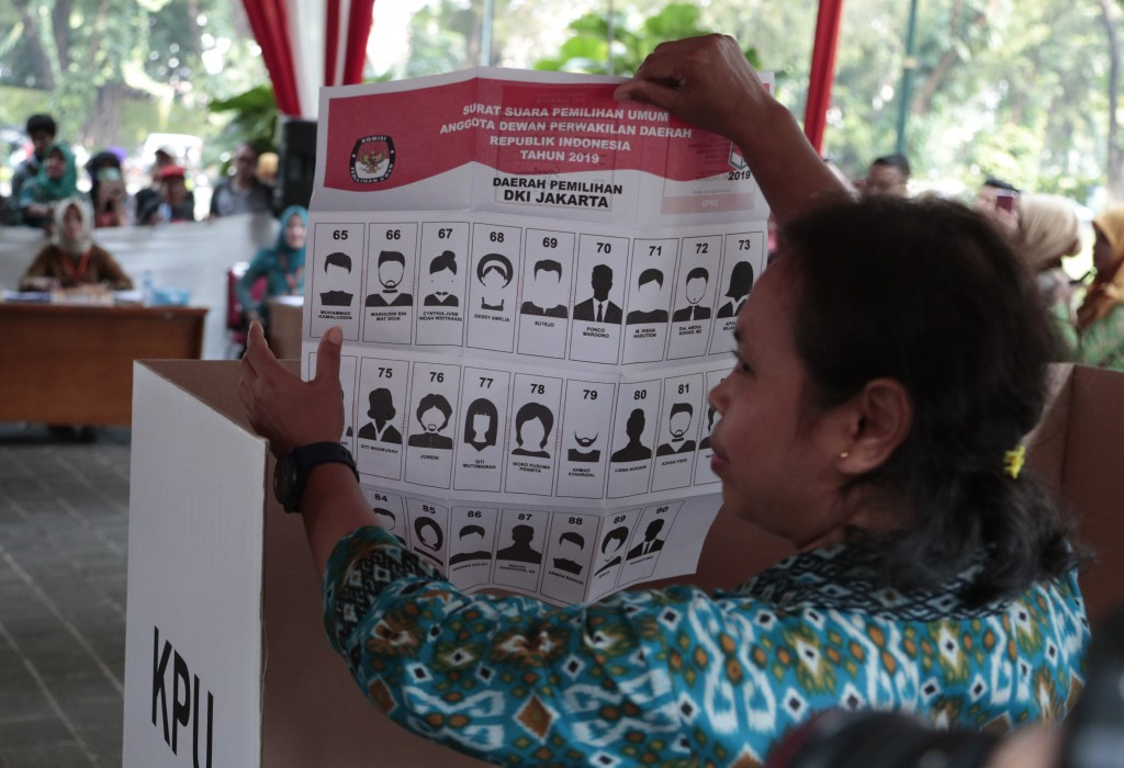 In this Wednesday, April 10, 2019, file photo, a woman shows a mock ballot for the senate during a polling simulation exercise held by the election co