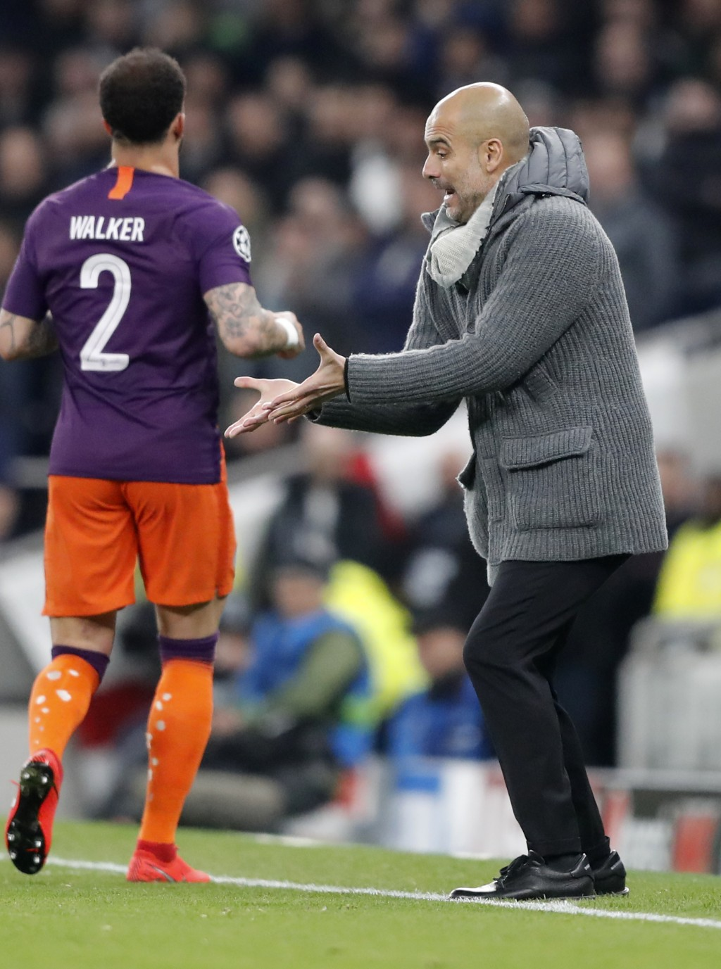 Manchester City coach Pep Guardiola gestures during the Champions League, round of 8, first-leg soccer match between Tottenham Hotspur and Manchester ...