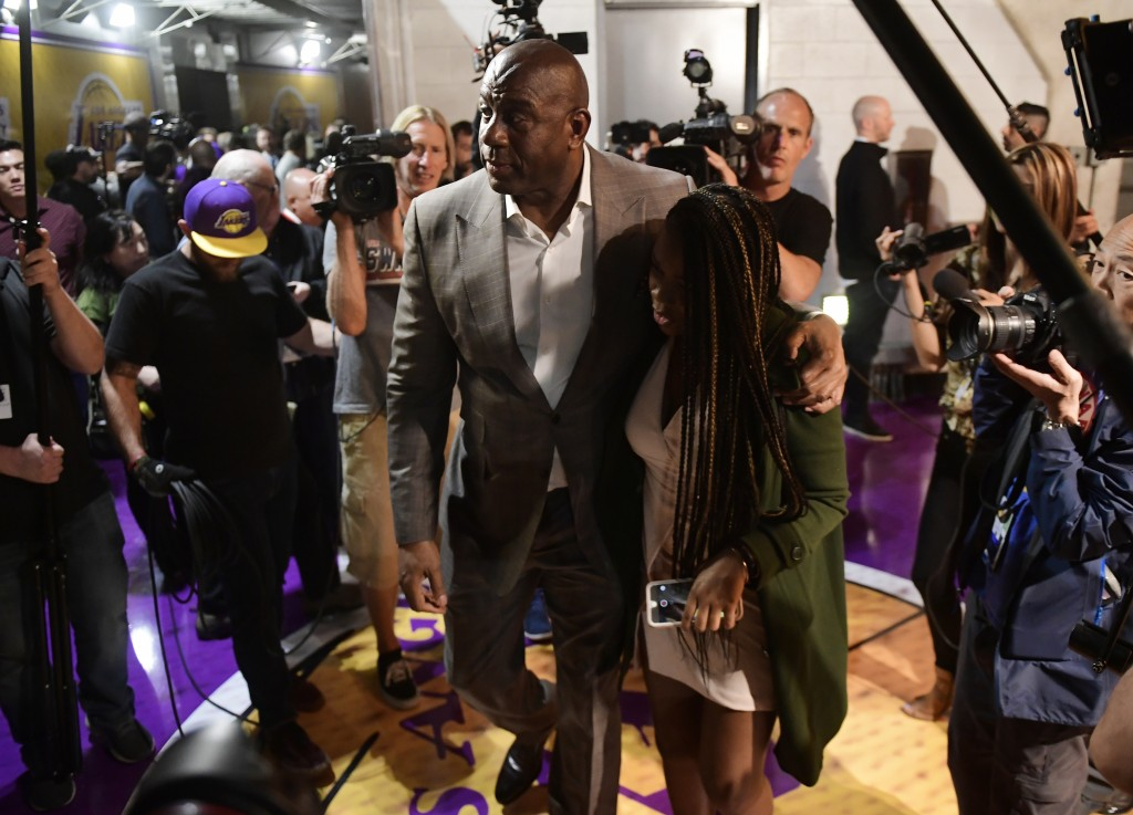 Magic Johnson leaves after speaking to reporters prior to an NBA basketball game between the Los Angeles Lakers and the Portland Trail Blazers on Tues...
