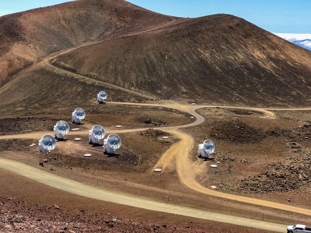 This April 4, 2019, photo, provided by Maunakea Observatories shows the Submillimeter Array, part of the Event Horizon Telescope network on the summit