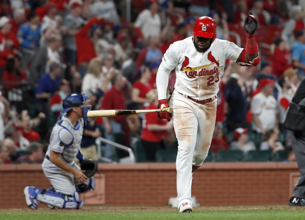 St. Louis Cardinals' Marcell Ozuna (23) tosses aside his bat as Los Angeles Dodgers catcher Austin Barnes, left, watches a two-run home run by Ozuna d