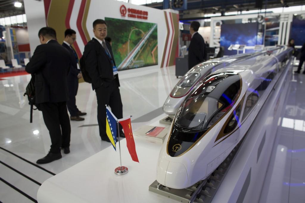 In this photo taken Tuesday, April 9, 2019, models of Chinese high speed trains are displayed at the trade fair in Mostar, Bosnia. Chinese investments
