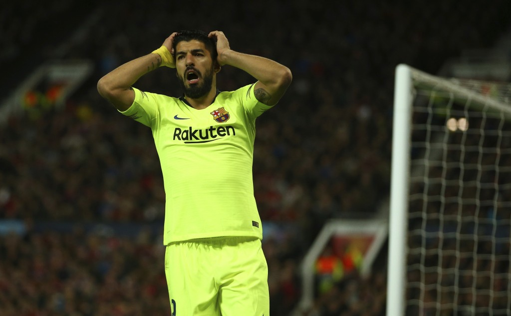 Barcelona's Luis Suarez reacts after missing an opportunity during the Champions League quarterfinal, first leg, soccer match between Manchester Unite