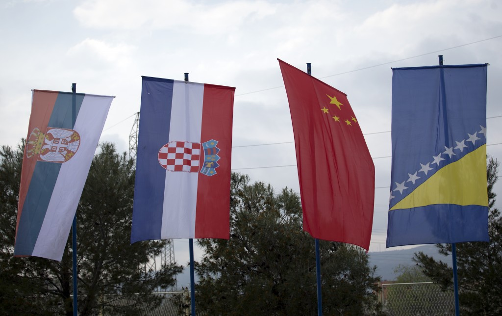 In this photo taken Tuesday, April 9, 2019, Serbian, Croatian, Chinese and the Bosnian flags at the trade fair in Mostar, Bosnia. Chinese investments