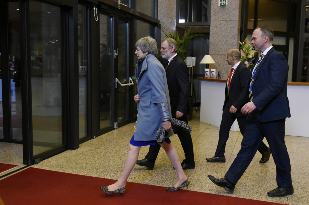 British Prime Minister Theresa May, left, leaves with her delegation at the conclusion of an EU summit in Brussels, Thursday, April 11, 2019. European...