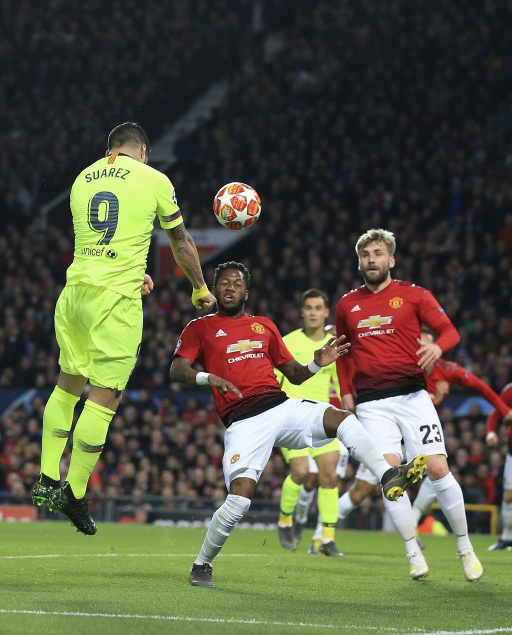 Barcelona's Luis Suarez scores the opening goal of his team during the Champions League quarterfinal, first leg, soccer match between Manchester Unite...