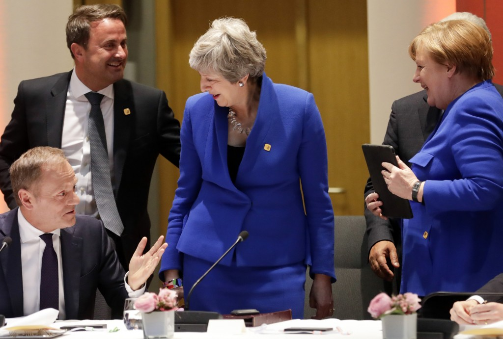 European Council President Donald Tusk, left, speaks with British Prime Minister Theresa May, center, German Chancellor Angela Merkel, right, and Luxe...