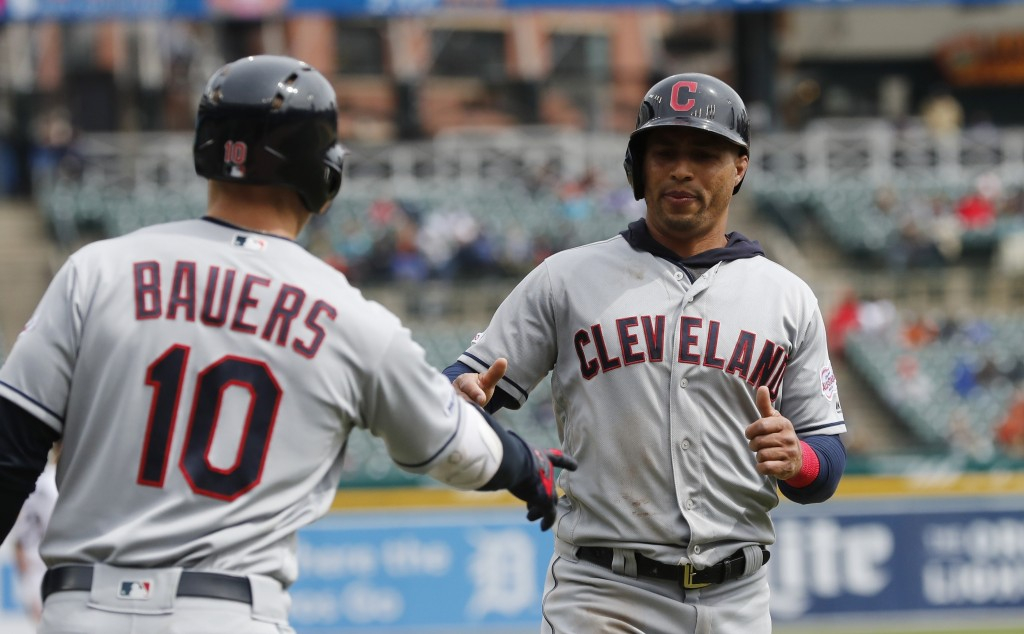 Cleveland Indians center fielder Leonys Martin is greeted by teammate Jake Bauers after scoring on a double by Jose Ramirez during the sixth inning of...