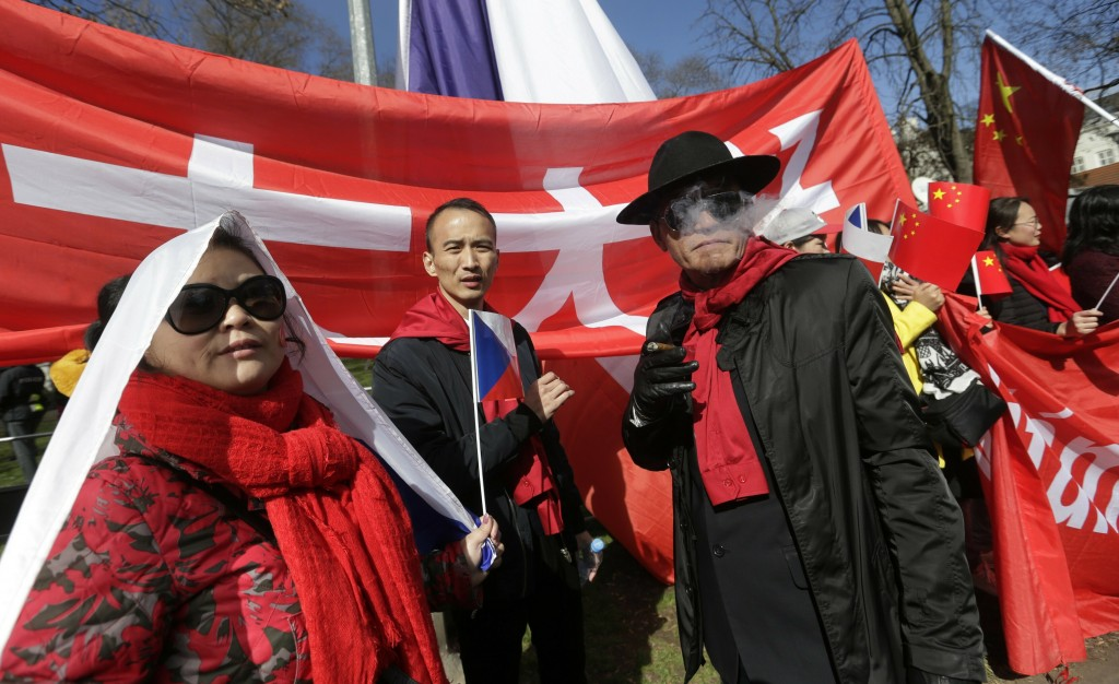FILE - In this March 29, 2016, file photo, China supporters attend a rally in support of Chinese President Xi Jinping during his visit in Prague, Czec