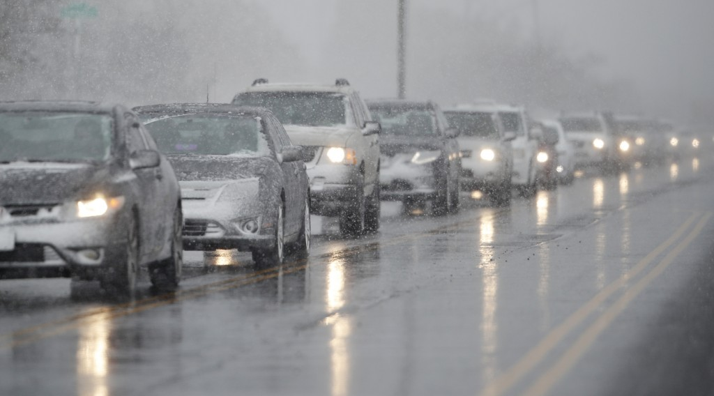 Traffic backs up along 56th Avenue as a spring storm rolls in before the evening rush hour Wednesday, April 10, 2019, in Denver. Blizzard warnings hav...
