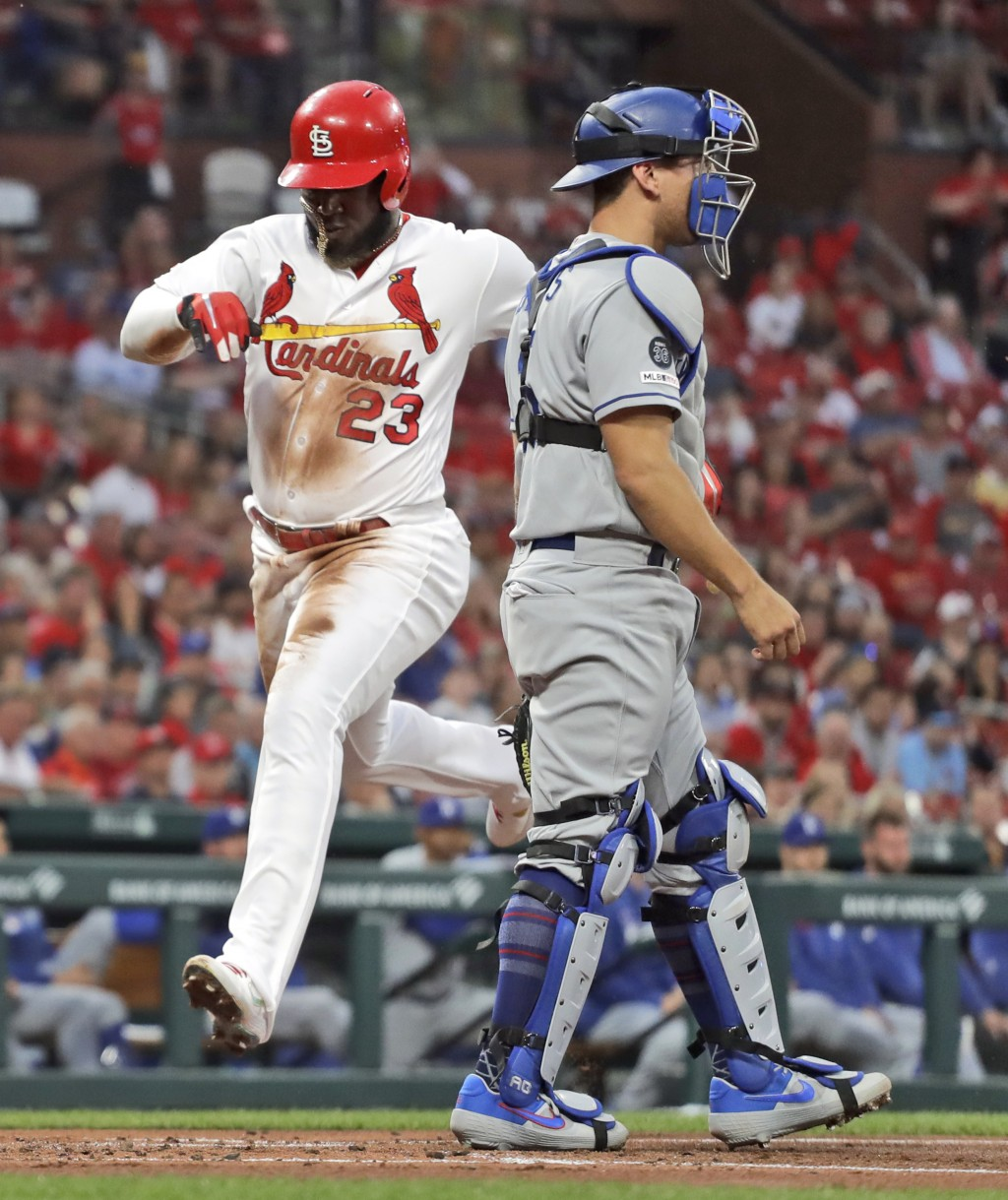 St. Louis Cardinals' Marcell Ozuna (23) scores past Los Angeles Dodgers catcher Austin Barnes during the second inning of a baseball game Wednesday, A