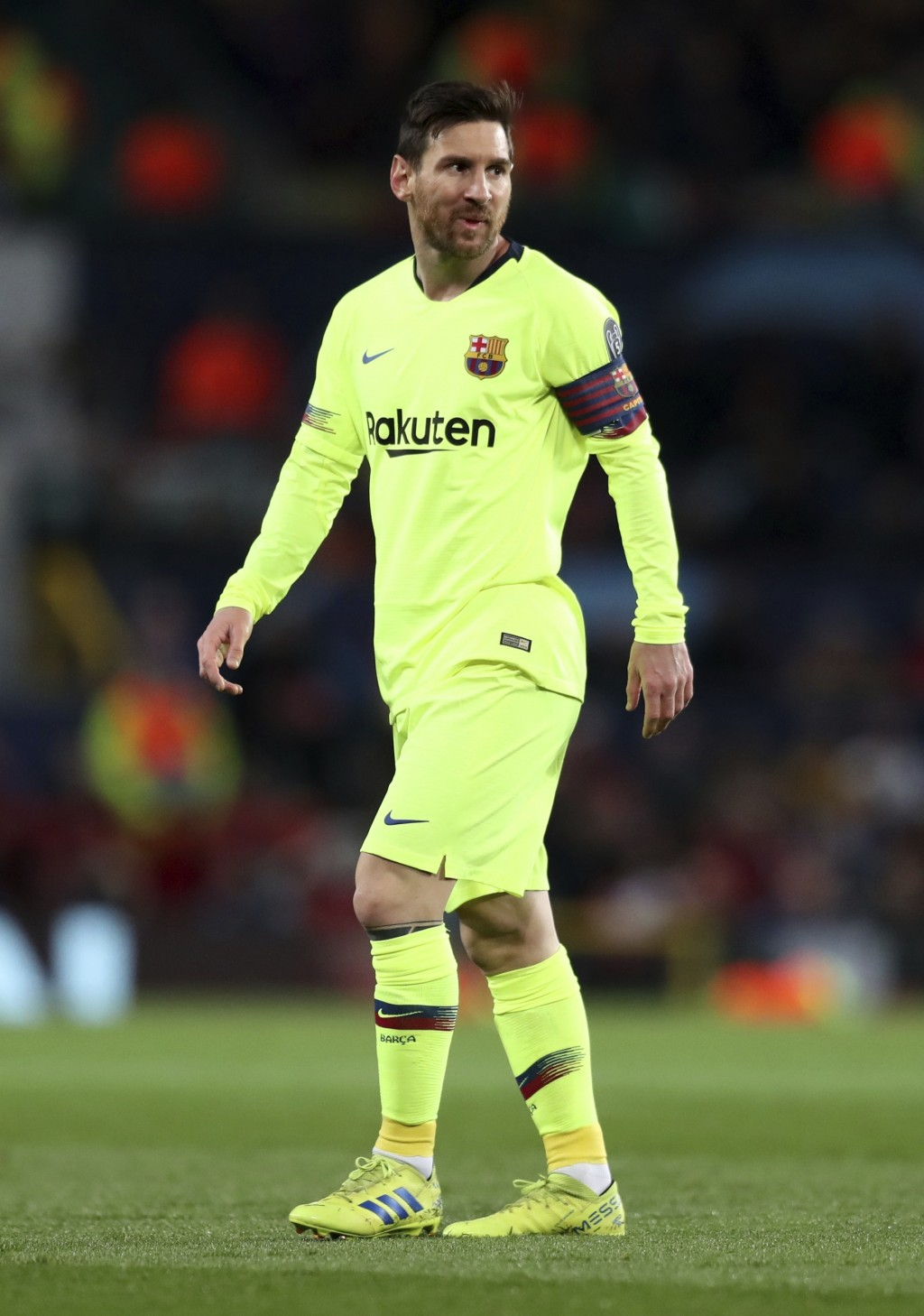 Barcelona's Lionel Messi reacts during the Champions League quarterfinal, first leg, soccer match between Manchester United and FC Barcelona at Old Tr...
