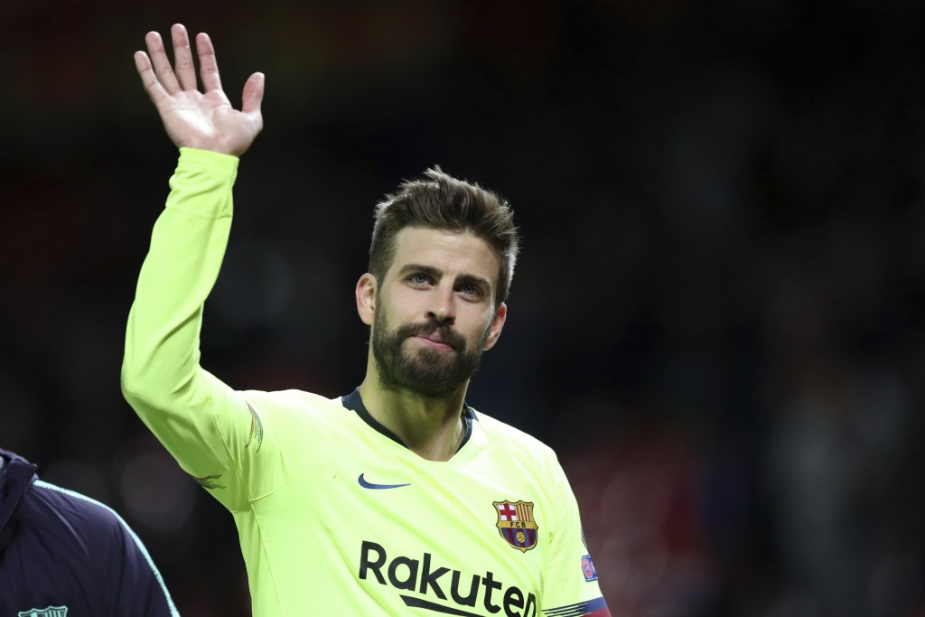 Barcelona's Gerard Pique waves to the fans after the Champions League quarterfinal, first leg, soccer match between Manchester United and FC Barcelona