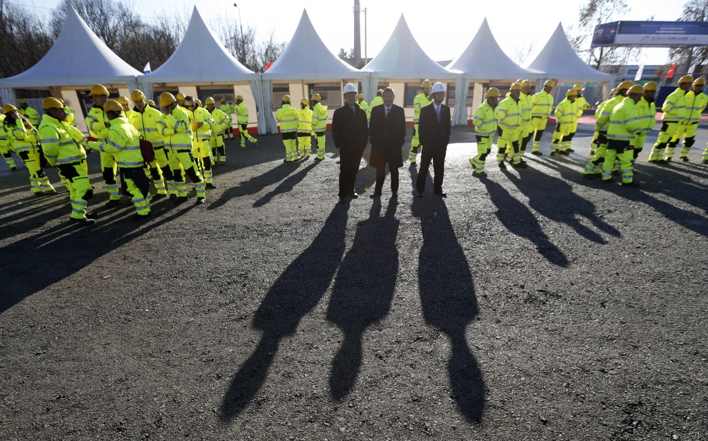 FILE - In this Nov. 28, 2017, file photo, workers and officials await the ceremony of the reconstruction of a railway line between Budapest and Belgra