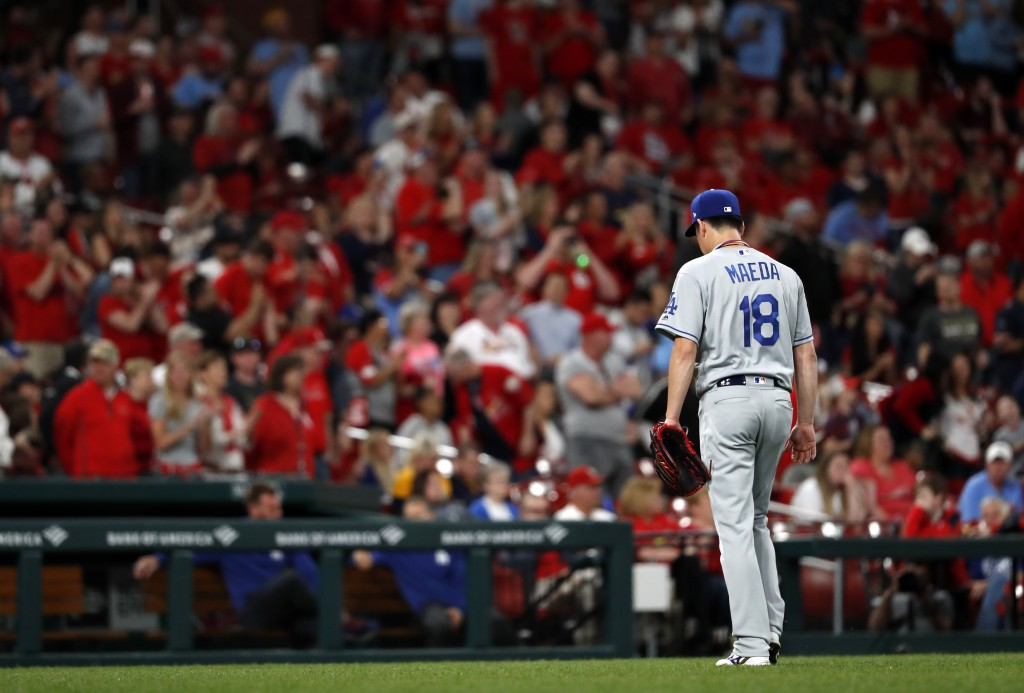 Los Angeles Dodgers starting pitcher Kenta Maeda leaves the baseball game after giving up a two-run home run to St. Louis Cardinals' Yadier Molina dur