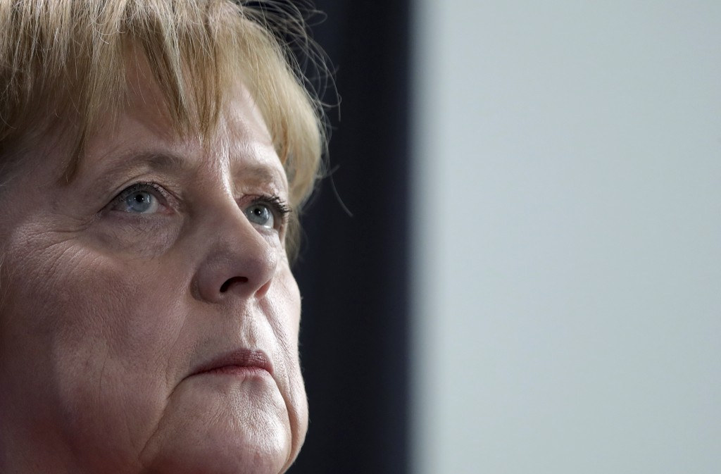 German Chancellor Angela Merkel looks up during joint press conference with the President of Ukraine, Petro Poroshenko, as part of a meeting at the ch...