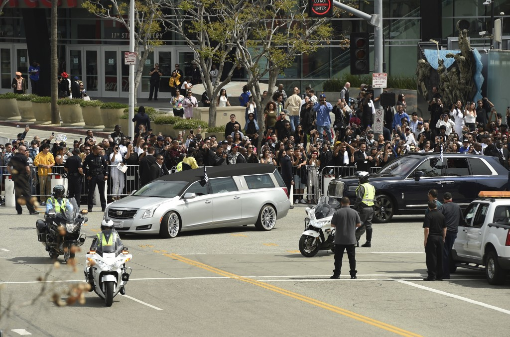 A silver hearse carrying the body of Nipsey Hussle, whose given name was Ermias Asghedom, leaves Staples Center in a procession following the Celebrat