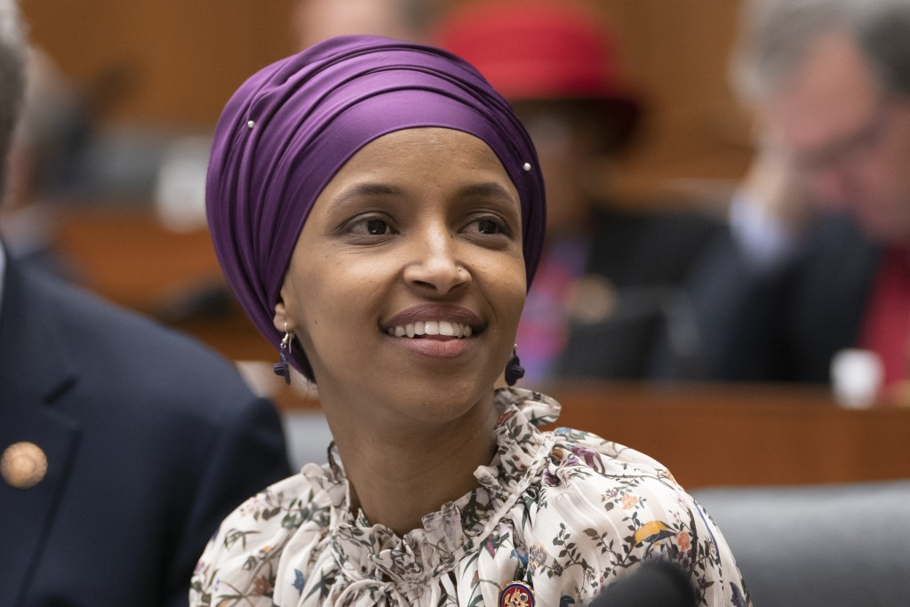 Rep. Ilhan Omar, D-Minn., sits with fellow Democrats on the House Education and Labor Committee during a bill markup, on Capitol Hill in Washington, W