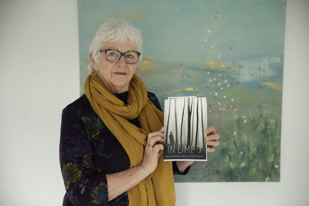 "Elly Wright, a Dutch painter who has lived in Britain for 51-years, poses for photographs with a copy of the book ""In Limbo"", in which her Brexit test"