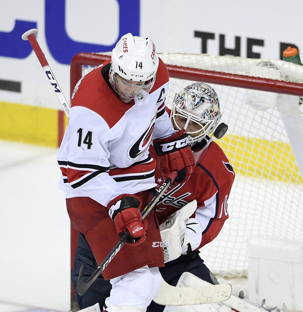 Carolina Hurricanes right wing Justin Williams (14) works for the puck against Washington Capitals goaltender Braden Holtby (70) during the third peri